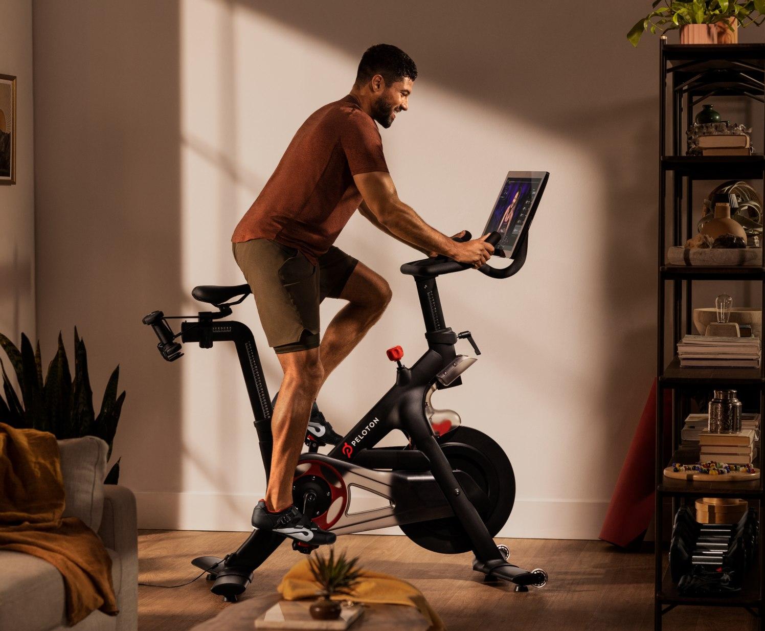 A Peloton customer enjoying the Bike in their home.