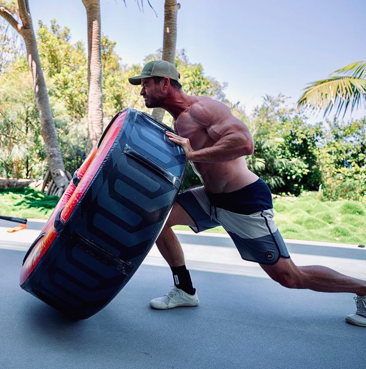 Chris Hemsworth muscles flipping tyre