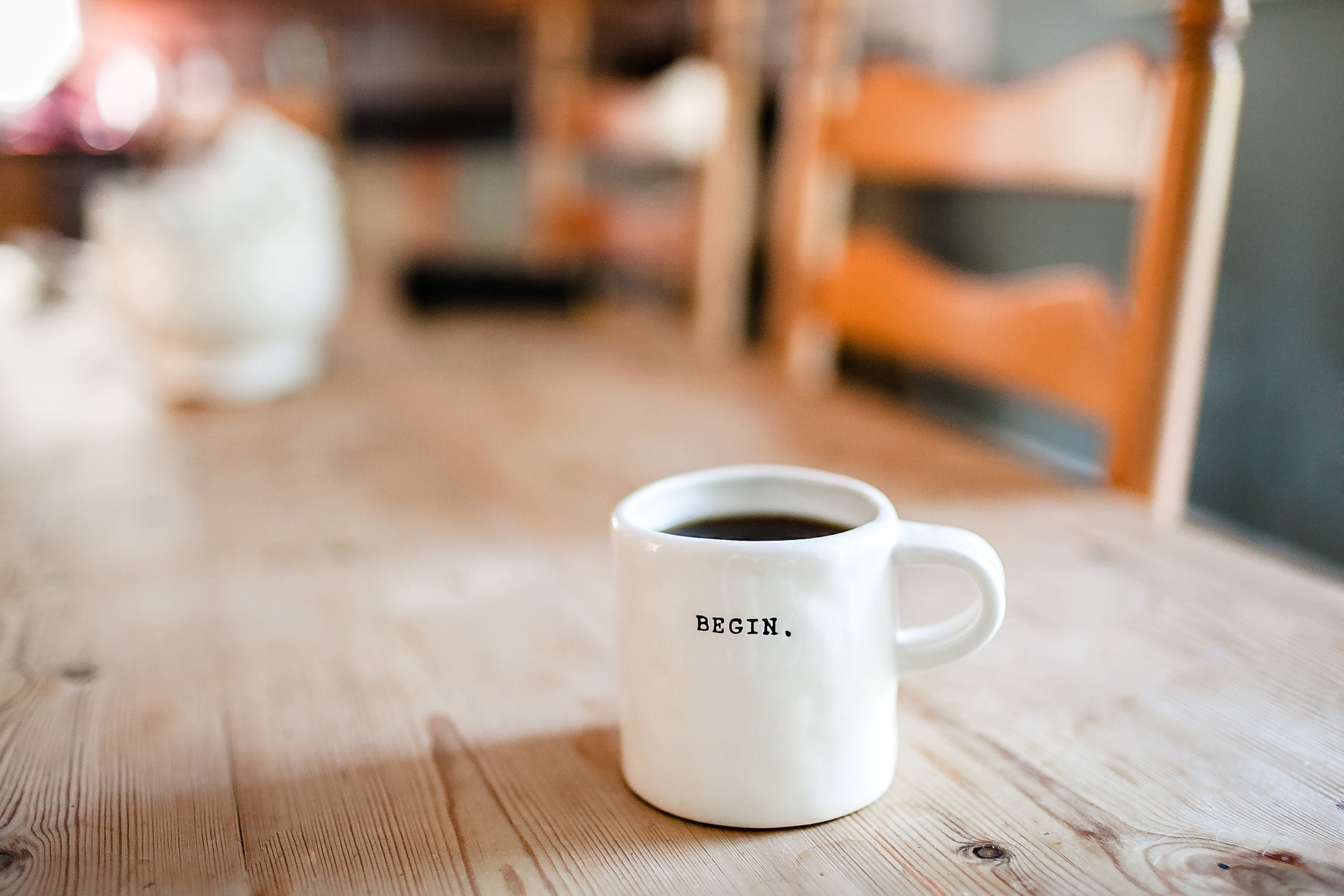 "a mug that says ""begin"" on it"