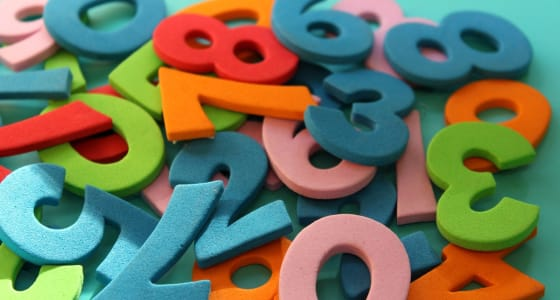 pile of felt numbers in numerous colours including green, blue and red