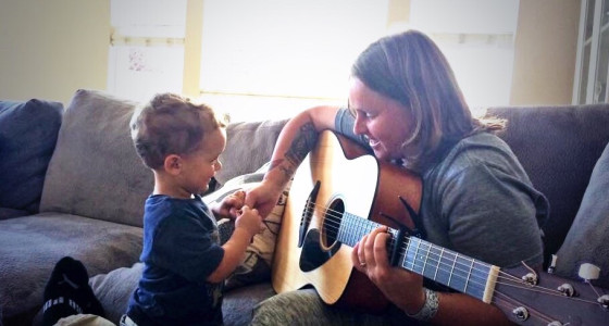 Man with son and guitar