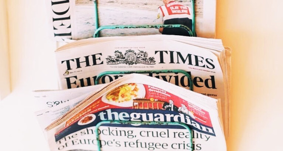 Rack of newspapers including the Guardian, Time and Independent