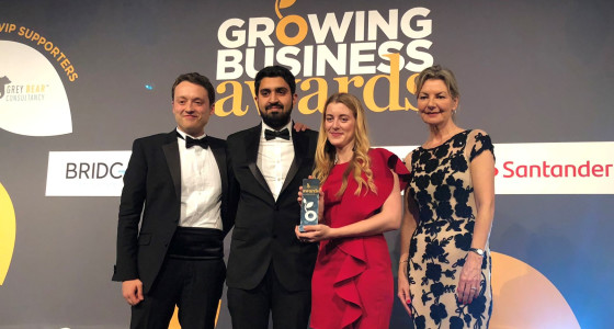 PensionBee employees collecting growing business award