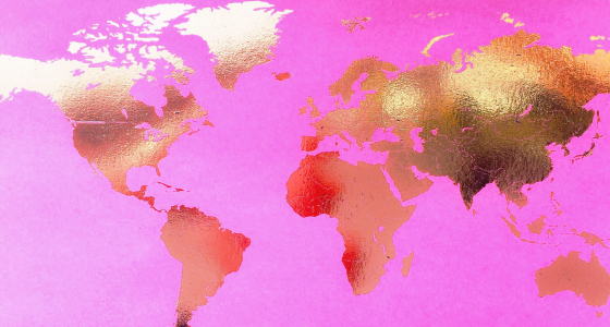 World map with gold countries on a pink background