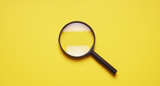 magnifying glass with a yellow background