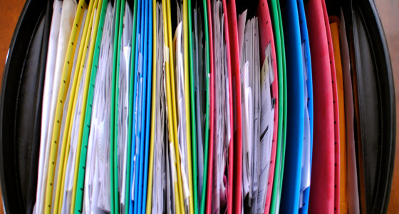 Black drawer filled with brightly coloured folders