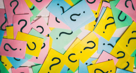Brightly coloured post it notes with questions marks on