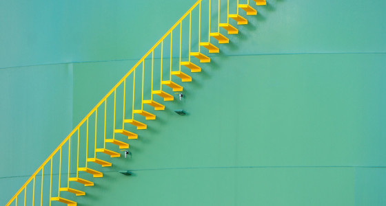 light green background with a straight yellow staircase in front