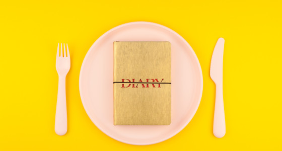 A diary on a bright yellow background
