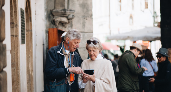 A retired couple exploring a city on holiday