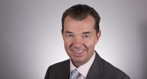 Pensions Minister, Guy Opperman, in front of white background