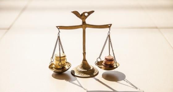 Gold unbalanced scales