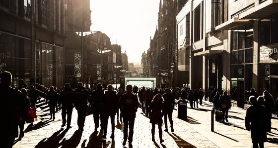 Many people walking down Buchanan street in Glasgow, Scotland