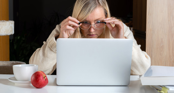 Shocked lady staring at a laptop screen