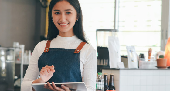 Young women working in a cafe as a barista