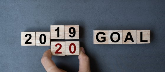 Small wooden cubes with the words 2019, 2020 goals printed on