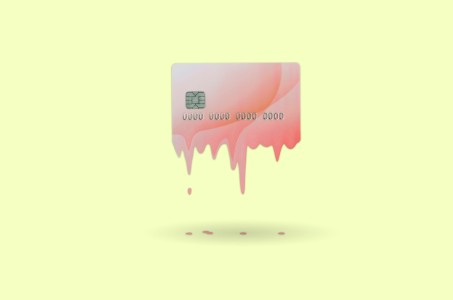 A pink credit card melting on a yellow background