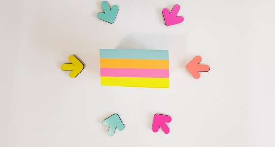 Several coloured arrows pointing to a coloured rectangle.