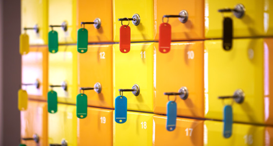Numbered secure lockers with keys.