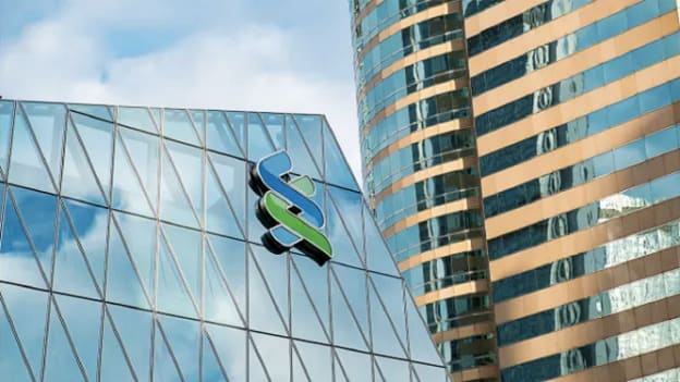 Standard Chartered to cut hundreds of jobs