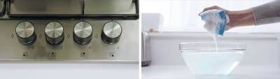 Buttons on stove in off position and hand squeezing  sponge until suds form above soapy water bowl