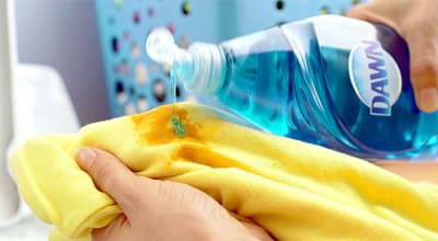 Use Dawn dish soap to pretreat laundry stains