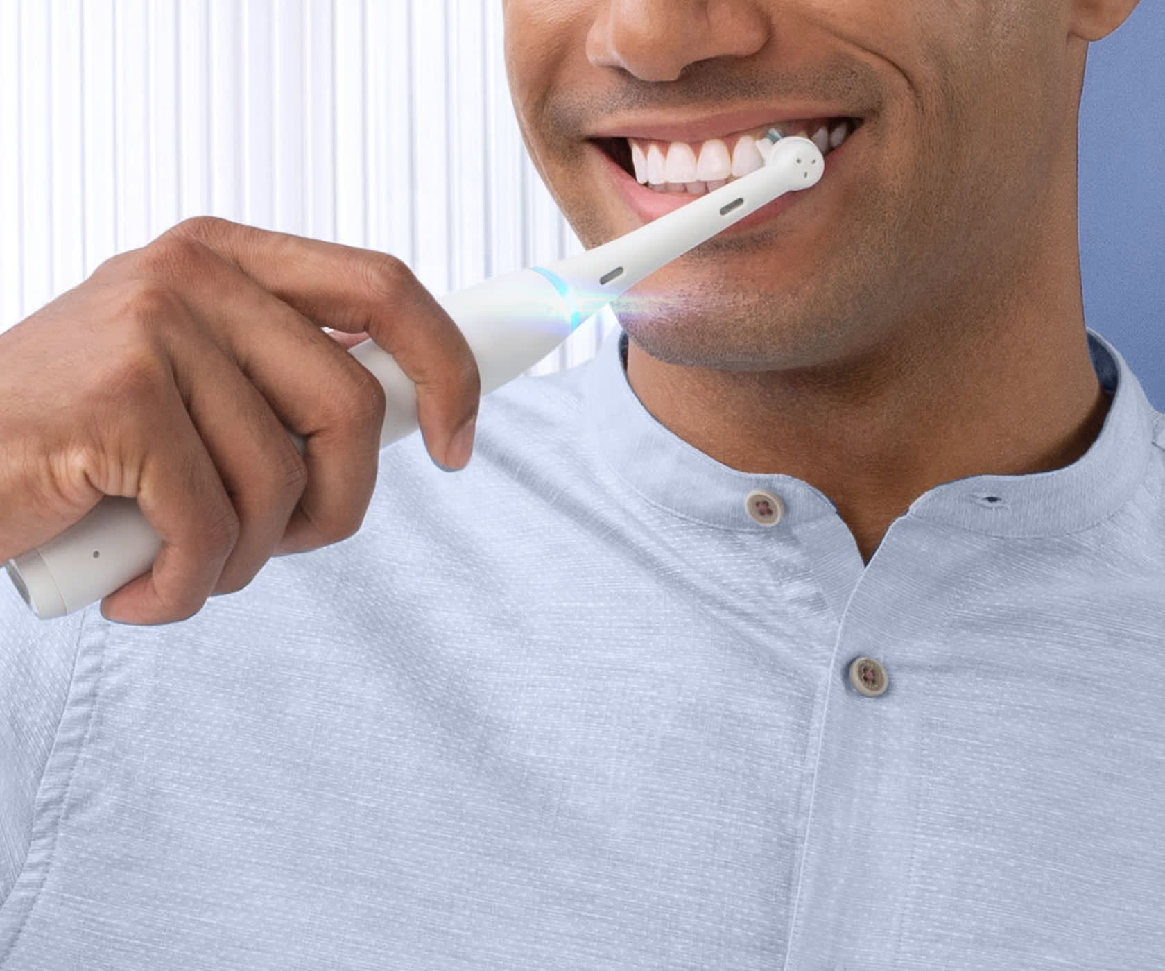Man brushing his teeth with Oral-B's iO Series 7 electric white toothbrush