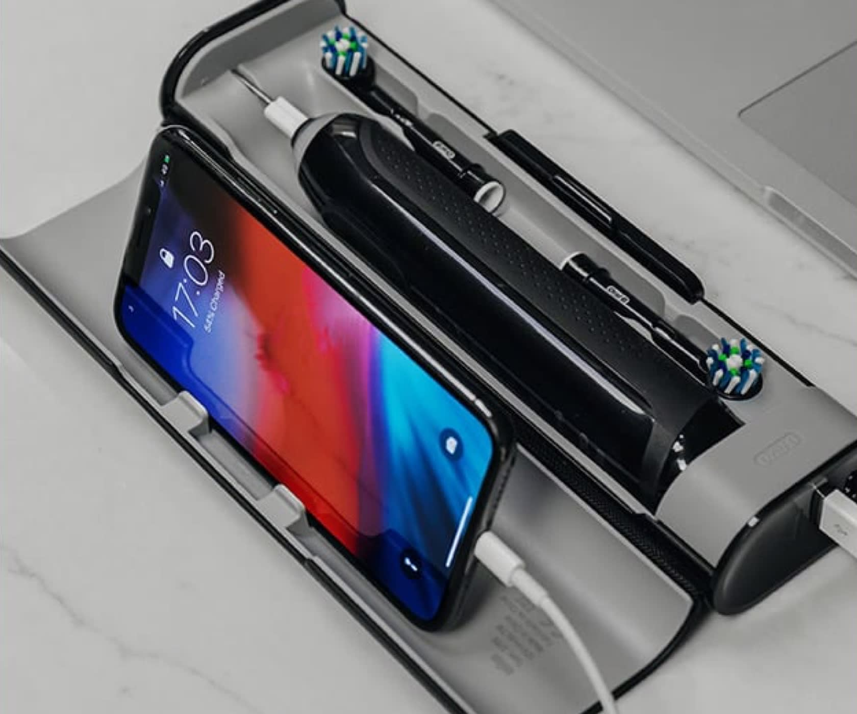 Premium travel case charges the Genius X brush and a phone at the same time undefined