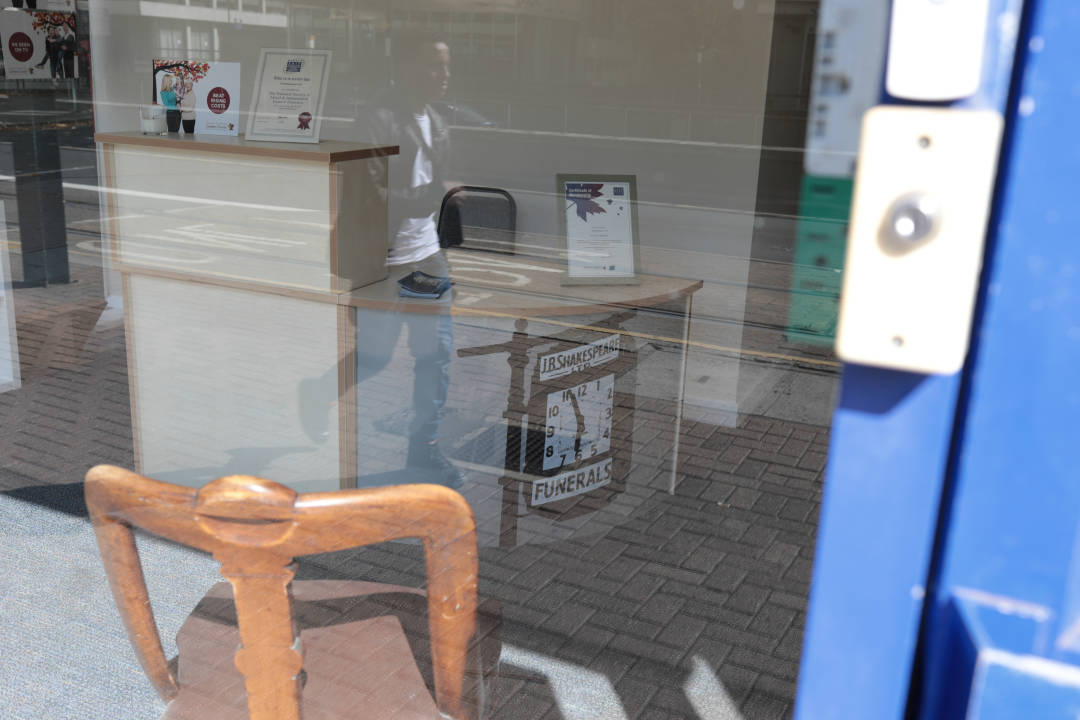 Photo of a funeral director's shopfront