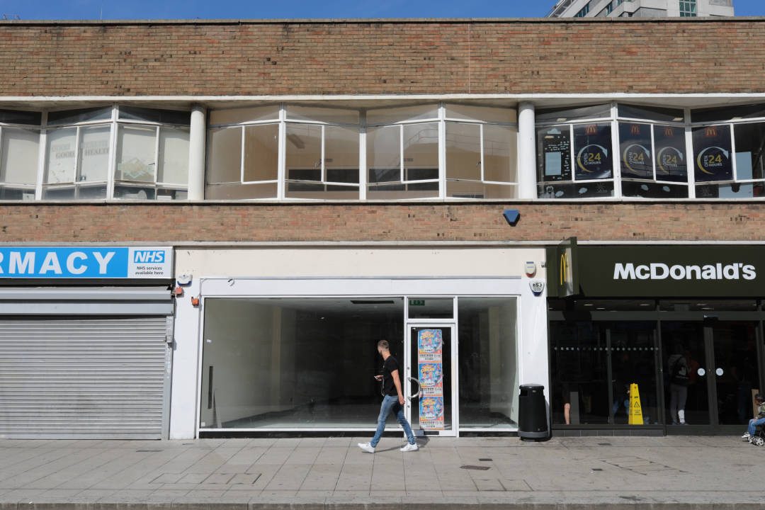 Photo of an empty unit on a retail street