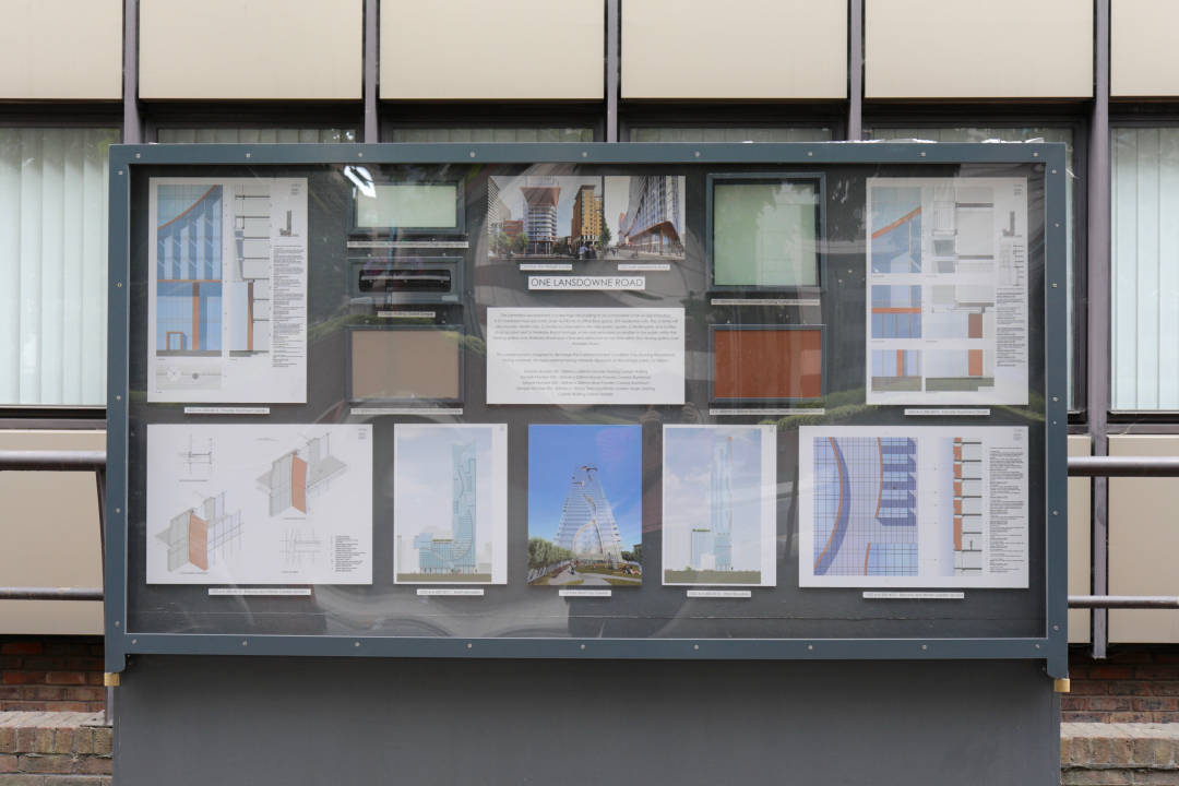 Photo of a sign showing building materials and diagrams for a building project