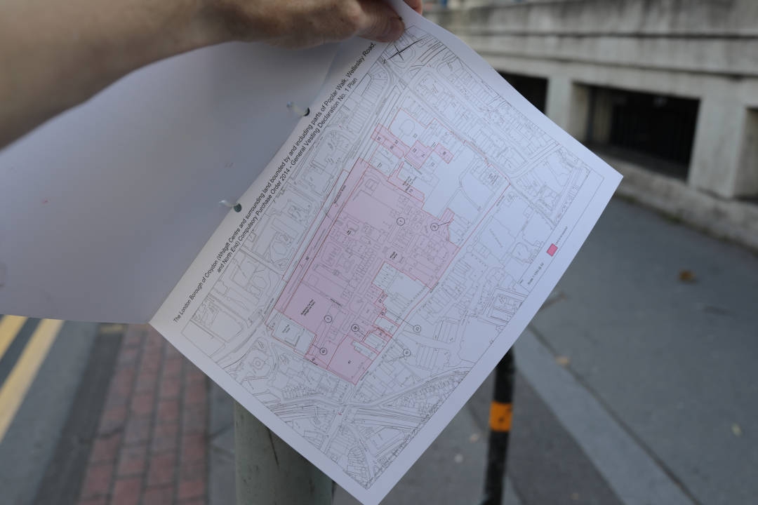 Photo of a document tied to a lamp post