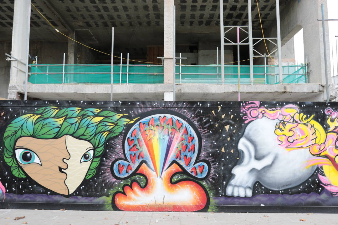 Photo of some colourful artwork painted on a building hoarding