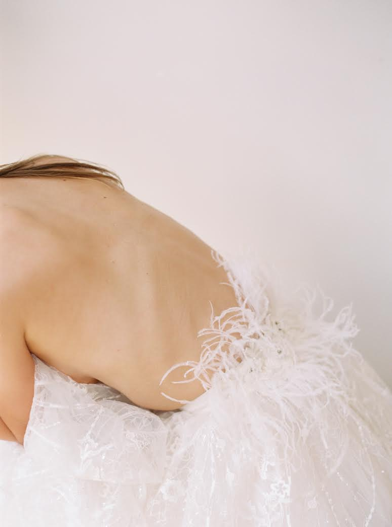 Film photo of a model in a white skirt against a white background by Elizabeth Gopal of @eastmadeco.