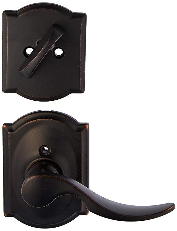 An image of Schlage F59STA716CAMRH Aged Bronze Lever Lockset Lock