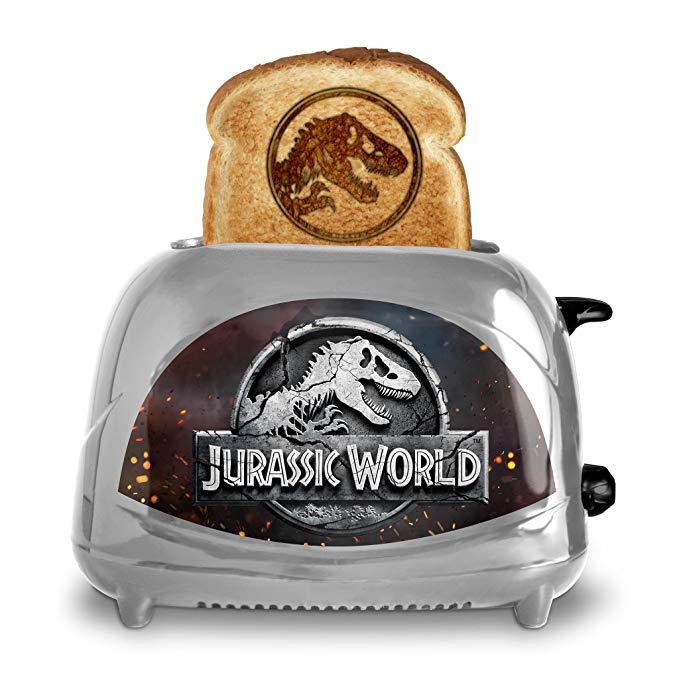 An image of Uncanny Brands TSTE-JUR-JFK Jurassic World: Fallen Kingdom 2-Slice Compact Cool Touch Toaster