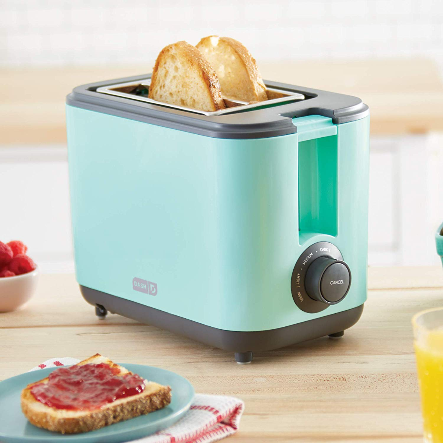 An image related to DASH DEZT001AQ Plastic Glacier Blue Cool Touch Toaster