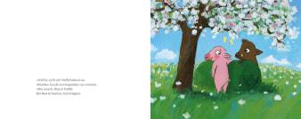 Innenansicht Doppelseite mit farbiger Illustration von zwei Schweinen unter Baum