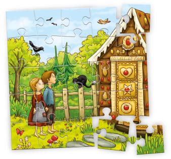 Innenansicht fertiges Puzzle mit farbiger Illustration von zwei Kindern vor Lebkuchenhaus