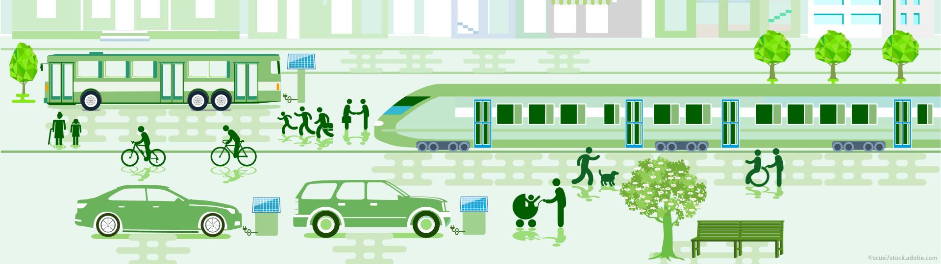 Eine Straße in der Stadt mit Bus, Zug, E-Autos, Fahrradfahrern und Fußgängern
