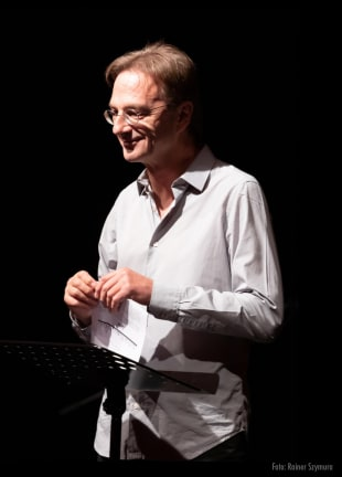 Fritz Eckenga auf der Bühne und im Radio