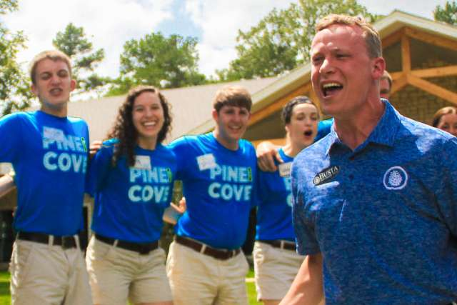 Staff cheer at Pine Cove