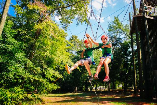 Campers laughing on the giant swing