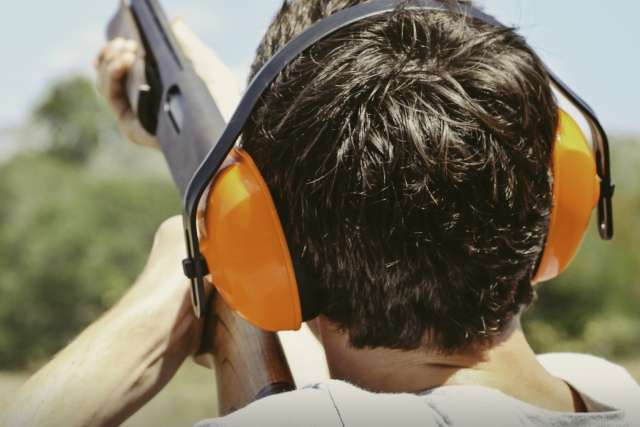 a teenager shooting skeet