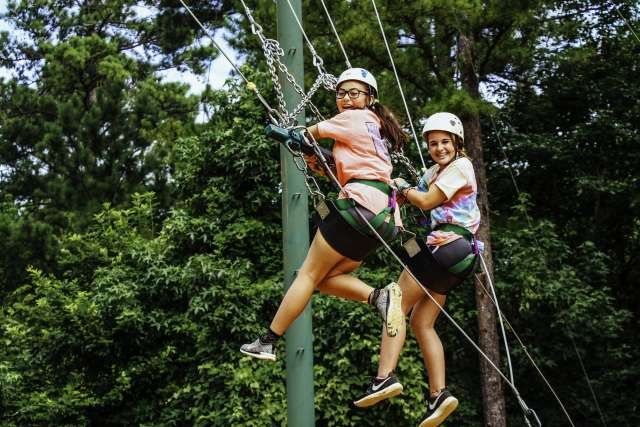 Two campers ride on the giant swing