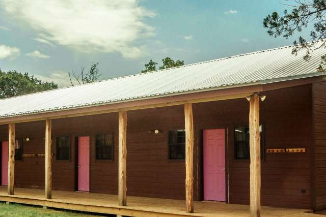 One story exterior of bunk bed-style cabins