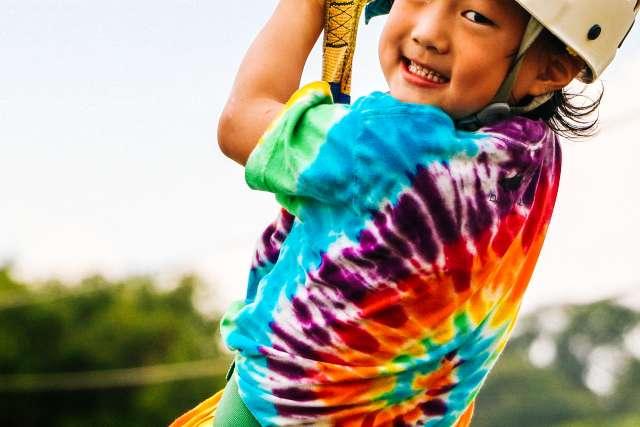 Camper smiling on the zipline
