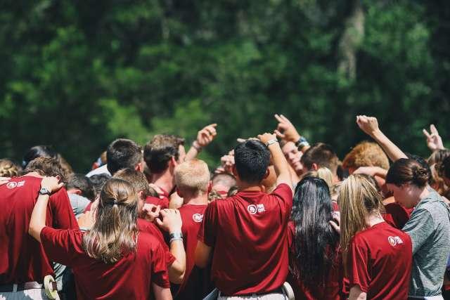 Staff Praying in a Huddle