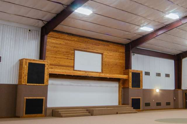 Timbers gym interior with basketball goals and stage