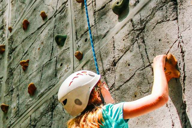 campers on the rock climbing wall